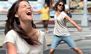 Katie Holmes shows off her fabulous form as she plays ball