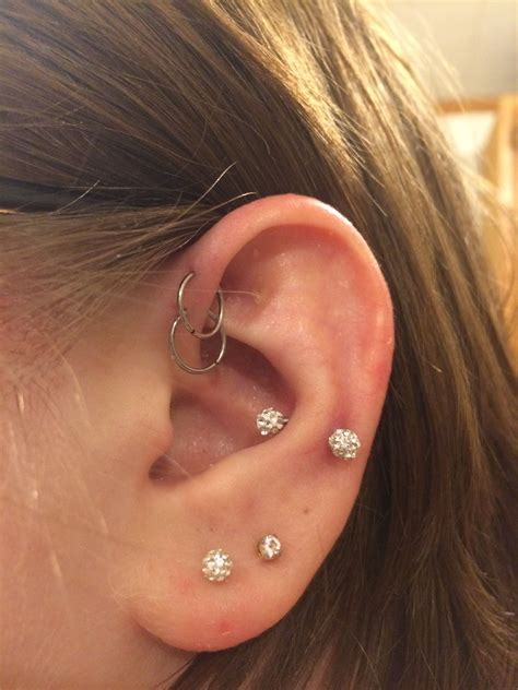 This is my snug and double helix piercings